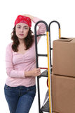 Woman with Moving Boxes. A pretty woman moving and shipping using a two wheel push cart Royalty Free Stock Photo