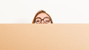 Woman moving in carrying box. Blank copyspace. Royalty Free Stock Image