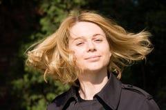 Woman moving hair outdoors Stock Photos