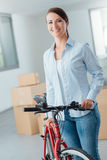 Woman moving with her bicycle Royalty Free Stock Photography