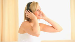 Woman moving her body while listening to music stock footage