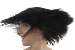A woman moving her head on white royalty free stock image