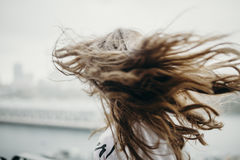 Woman moving her long hair. Royalty Free Stock Photo