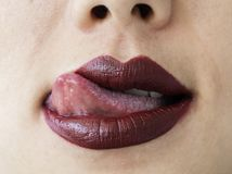 Woman moving her tongue over lips stock images