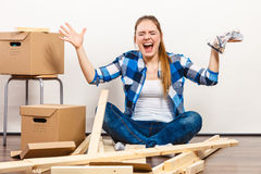 Woman moving in holding screws and furniture parts Royalty Free Stock Photography