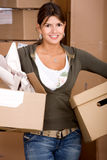 Woman moving home Stock Image