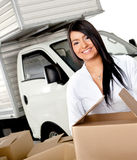 Woman moving house Stock Photos