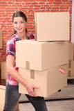 Woman moving house Royalty Free Stock Photography
