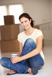 Woman moving into new home Stock Photography