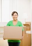 Woman moving into new home Stock Photos