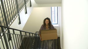 Woman Moving Into New Home Carrying Box Upstairs stock video
