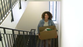 Woman Moving Into New Home Carrying Box Upstairs stock footage