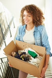 Woman Moving Into New Home Carrying Box Upstairs. Close Up Of Woman Moving Into New Home Carrying Box Upstairs royalty free stock photo