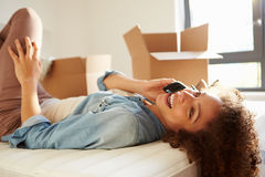 Woman Moving Into New Home Talking On Mobile Phone. Close Up Of A Woman Moving Into New Home Talking On Mobile Phone Smiling Stock Photos