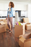 Woman Moving Into New Home Talking On Mobile Phone Royalty Free Stock Images