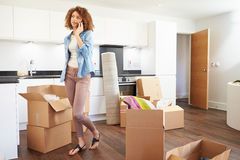 Woman Moving Into New Home Talking On Mobile Phone Royalty Free Stock Photo