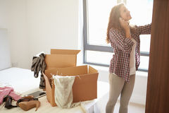 Woman Moving Into New Home Talking On Mobile Phone Stock Photography