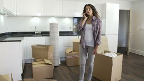 Woman Moving Into New Home Talking On Mobile Phone stock footage