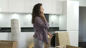 Woman Moving Into New Home Talking On Mobile Phone stock video footage