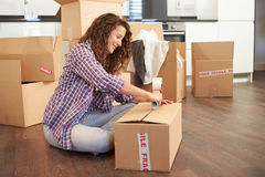 Woman Moving Into New Home And Unpacking Boxes Stock Photos