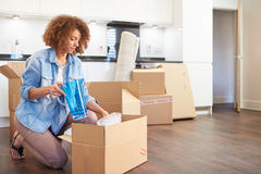 Woman Moving Into New Home And Unpacking Boxes Royalty Free Stock Photography