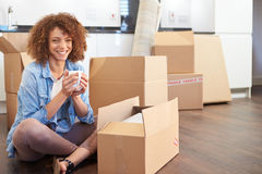Woman Moving Into New Home And Unpacking Boxes Stock Image