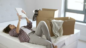Woman Moving Into New Home Using Digital Tablet stock video footage