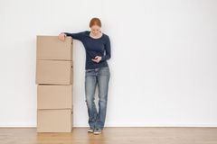 Woman Moving Out and Calling by Phone Royalty Free Stock Photos