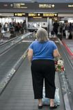 Woman on moving sidewalk. Woman on the moving sidewalk at an airport stock images
