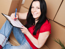 Woman moving to new house Stock Photo