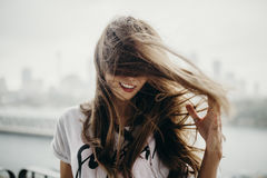 Woman moving and touching her haire. Royalty Free Stock Image