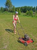 Woman mowing grass Royalty Free Stock Photo