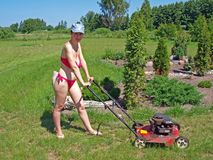 Woman mowing grass 2 Stock Photo
