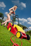 Woman mowing lawn Stock Image