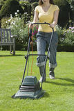 Woman Mowing Lawn Stock Photography