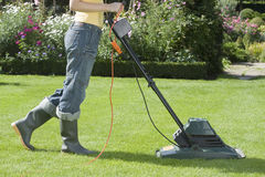 Woman Mowing Lawn Stock Photo