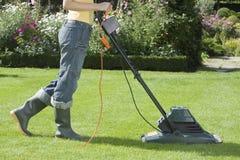 Woman Mowing Lawn Stock Photo