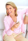 Woman with a mp3 player Stock Images