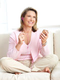 Woman with a mp3 player Royalty Free Stock Photos