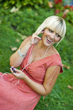 Woman with mp3 player Royalty Free Stock Photos