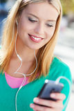 Woman with mp3 player Stock Images