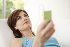 Woman with mp4 at Home Royalty Free Stock Photography