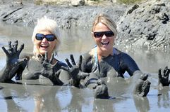 Woman in mud. Atractice blond womans in healing mud Stock Photography