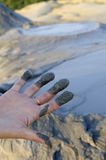 Woman with mud on fingers Stock Photography