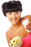 Woman with muesli and glass of milk Stock Photos