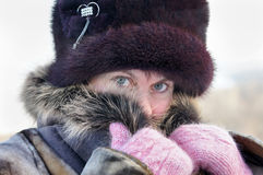 Woman muffles up in a fur collar Stock Photos