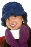Woman with mug. Young woman with winter hat and mittens holding mug of hot beverage Stock Image