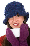 Woman with mug. Young woman with winter hat and mittens holding mug of hot beverage Stock Photo