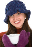 Woman with mug. Young woman with winter hat and mittens holding mug of hot beverage Royalty Free Stock Images