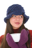 Woman with mug. Young woman with winter hat and mittens holding mug of hot beverage Royalty Free Stock Photography